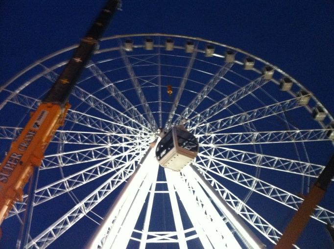 Placing the cars on the wheel at Asiatique